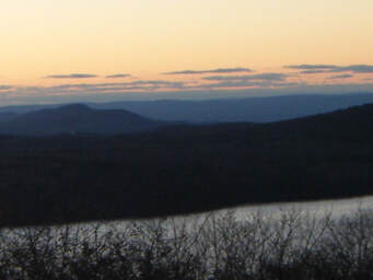 Orange sunset beyond lake & rolling-blue hills--'....the Lord restores my soul'